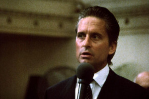 "Gekko (Douglas) gives the famous ""Greed is Good"" speech."